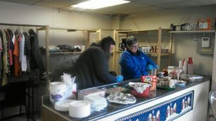 Volunteers serving snacks to the homeless